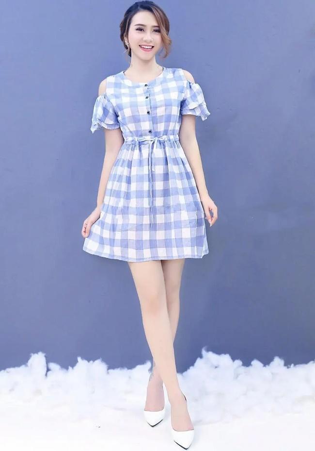 Nên chọn chiếc váy dài ngang gối nhằm ăn gian chiều cao của bạn
